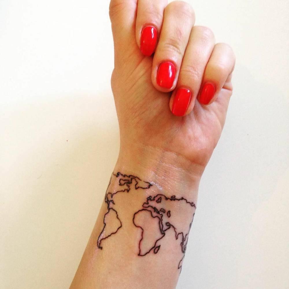 World map tattoo on Desi\'s wrist.