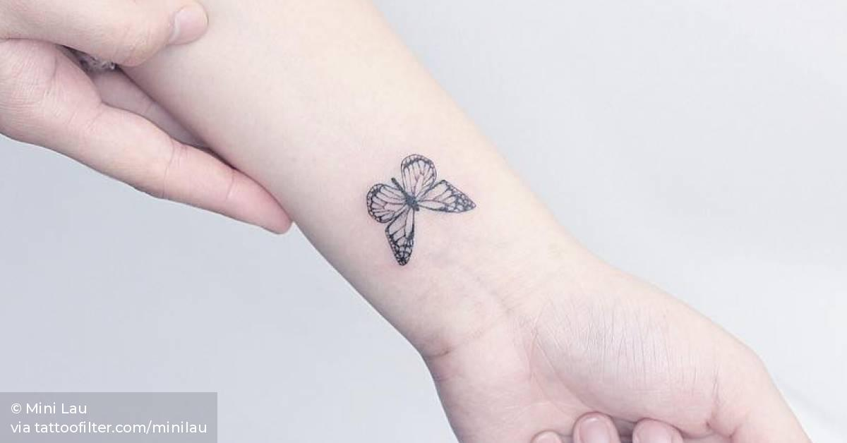Small Butterfly Tattoo On The Left Inner Wrist