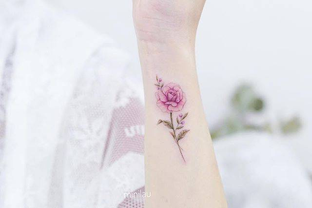Pink rose tattoo on the wrist.
