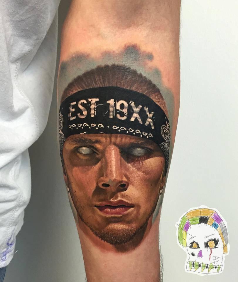 Realistic Machine Gun Kelly Portrait Tattoo On The Left