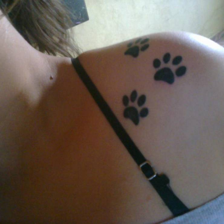 Shoulder Tattoo Of Three Dog Paws