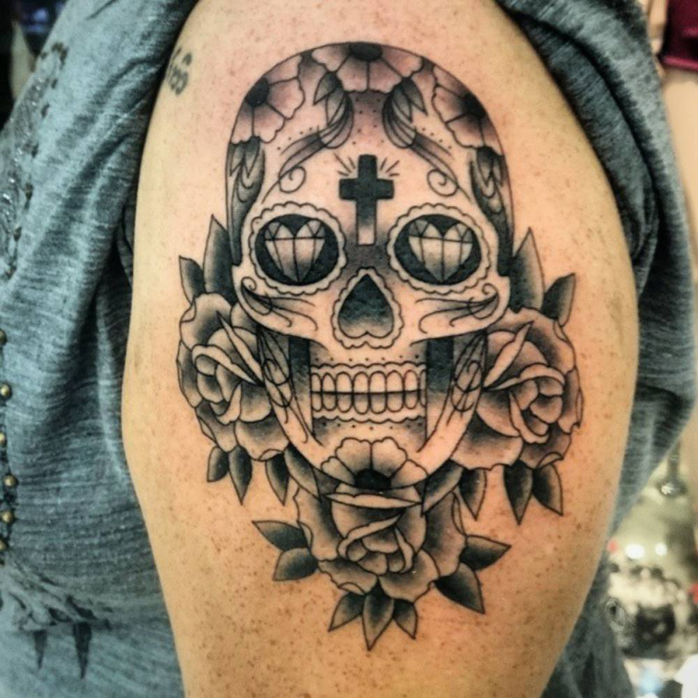 Shoulder Tattoo Of A Sugar Skull Together With Three
