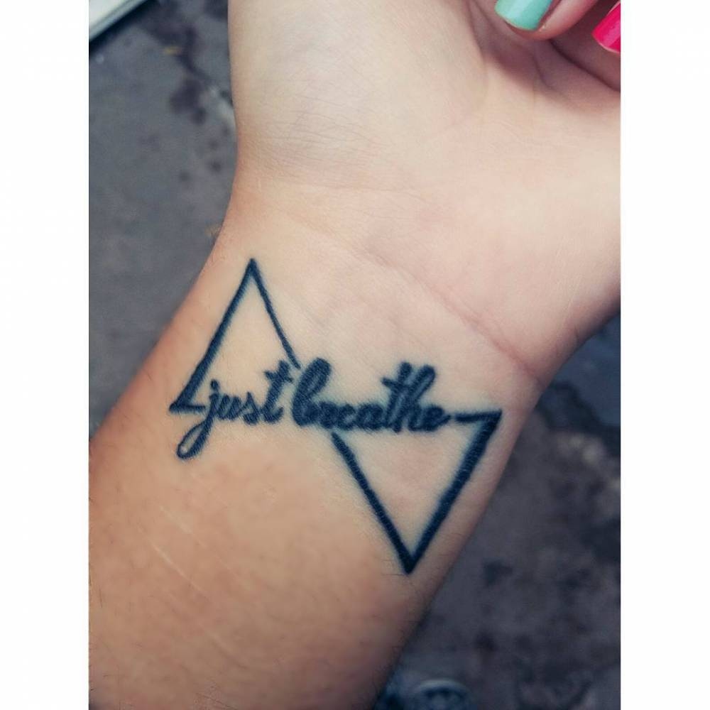 Geometric infinity tattoo saying \