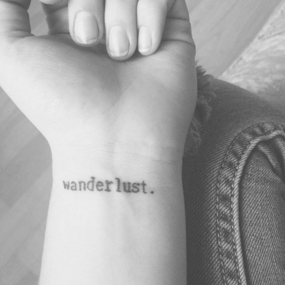 Little Wrist Tattoo Saying Wanderlust On Isidora
