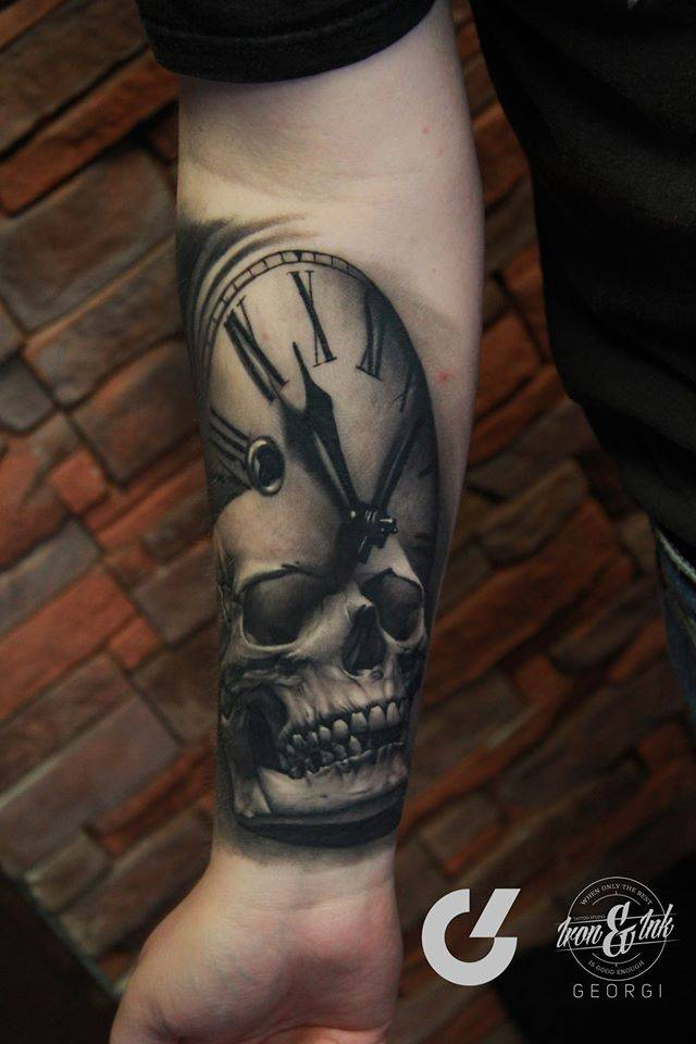 Healed Black And Grey Skull And Clock Tattoo On The