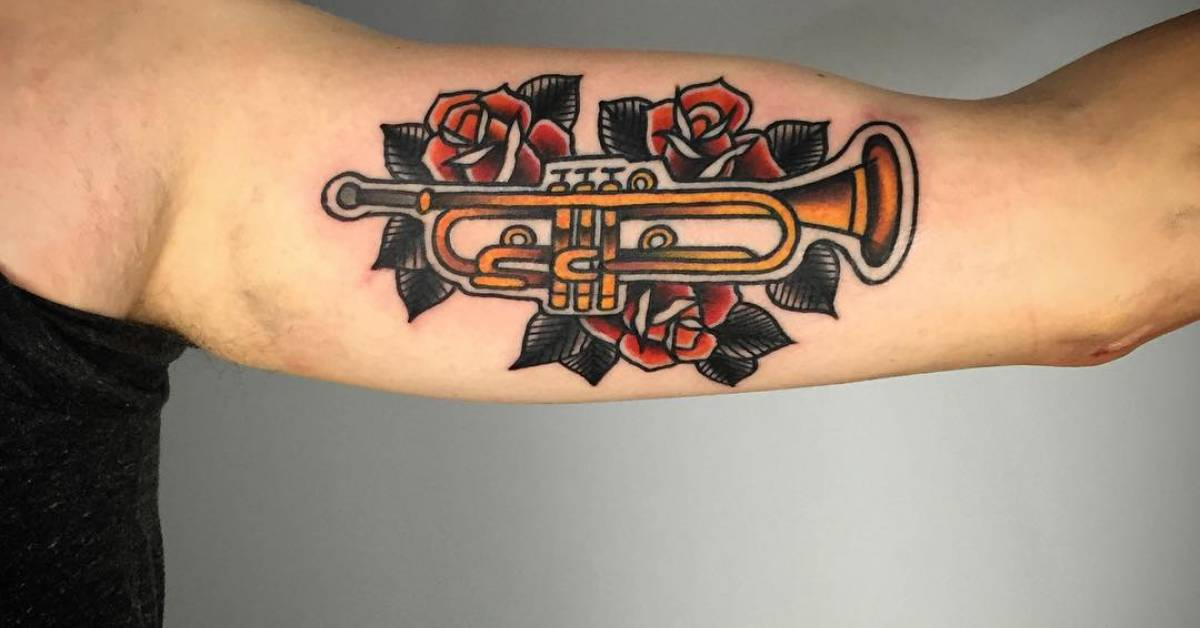 traditional style trumpet tattoo on the left inner arm. Black Bedroom Furniture Sets. Home Design Ideas