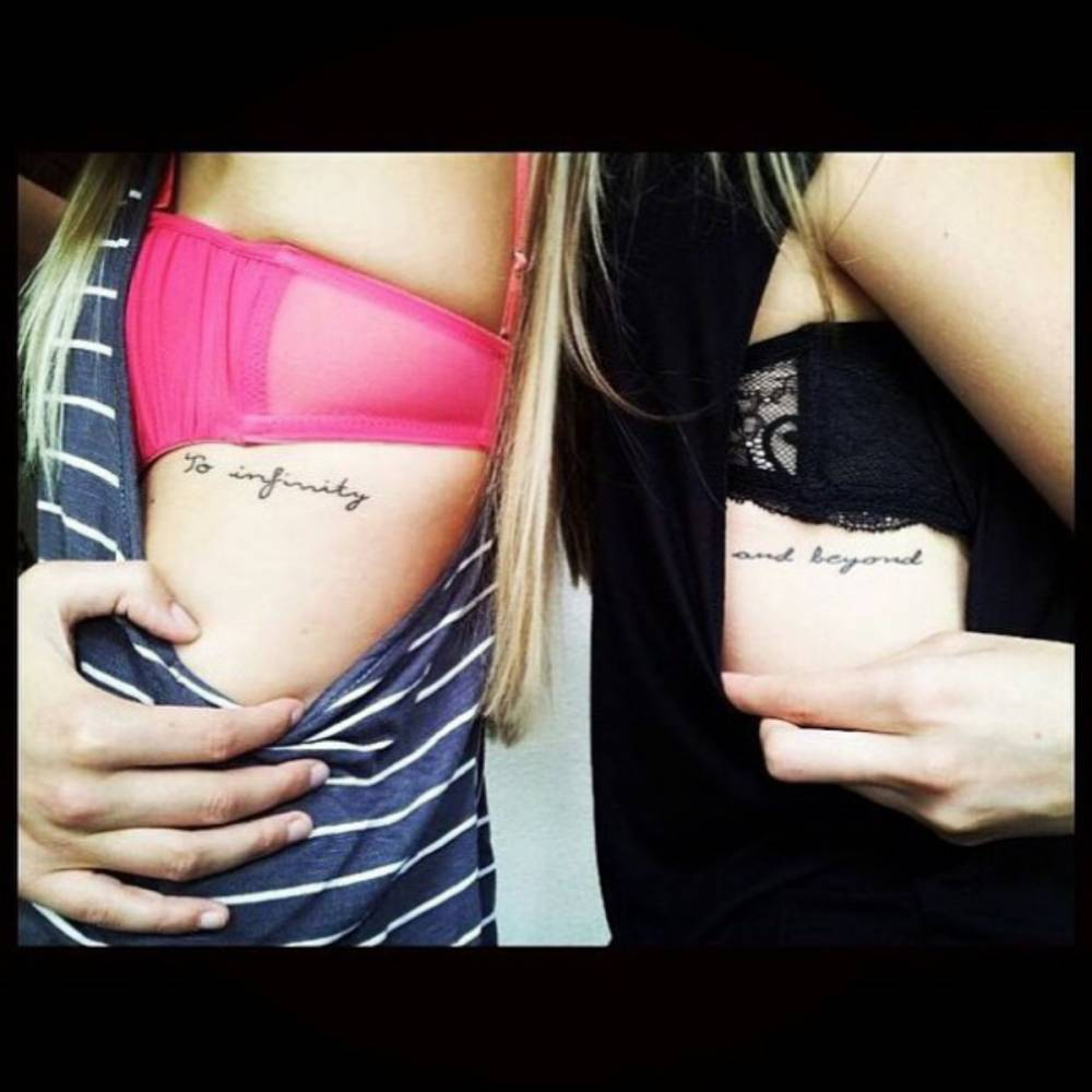 """to infinity and beyond"""" matching tattoo on stefanie"""