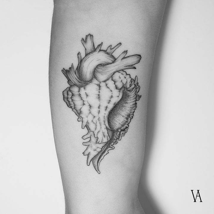 Surrealist anatomical heart sea snail tattoo on the