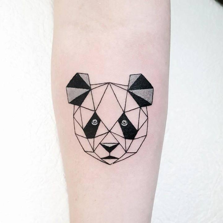 Polygonal panda bear tattoo on the right inner forearm.