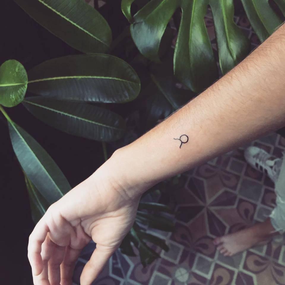 Tiny Taurus Zodiac Sign Tattoo On The Left Wrist