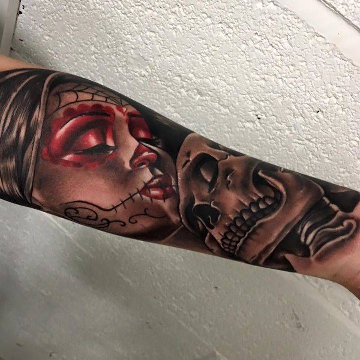 Realistic La Calavera Catrina and skull tattoo on the left forearm.
