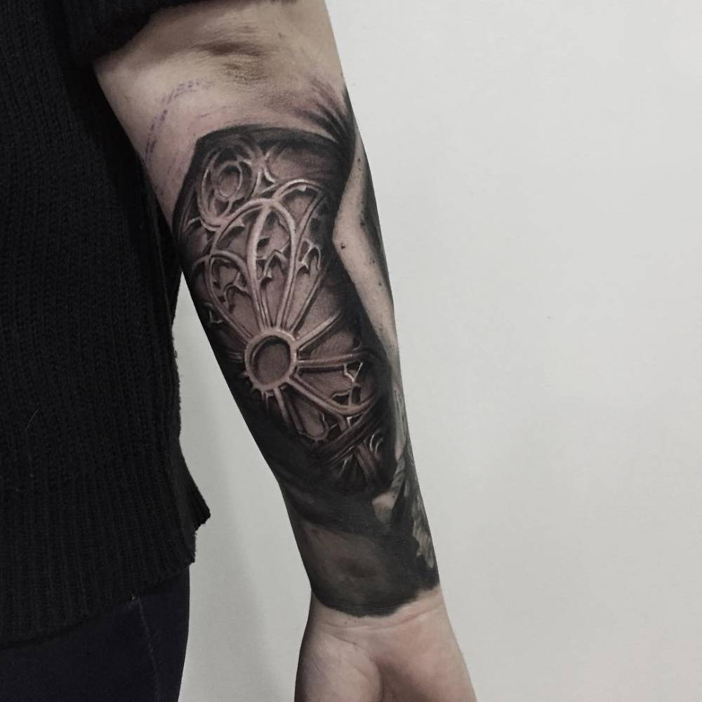 Black And Grey Rose Window Tattoo On The Right Forearm