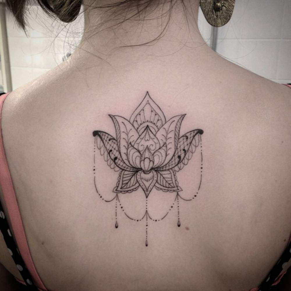 Upper Back Tattoo Of An Ornamental Style Lotus Flower