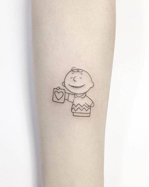 Charlie Brown tattoo on the inner forearm.