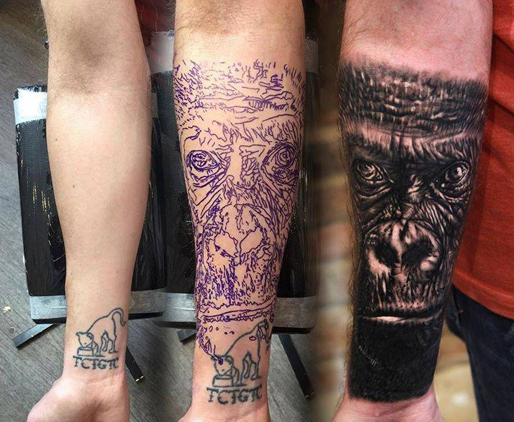 Black and grey gorilla tattoo cover up on the right