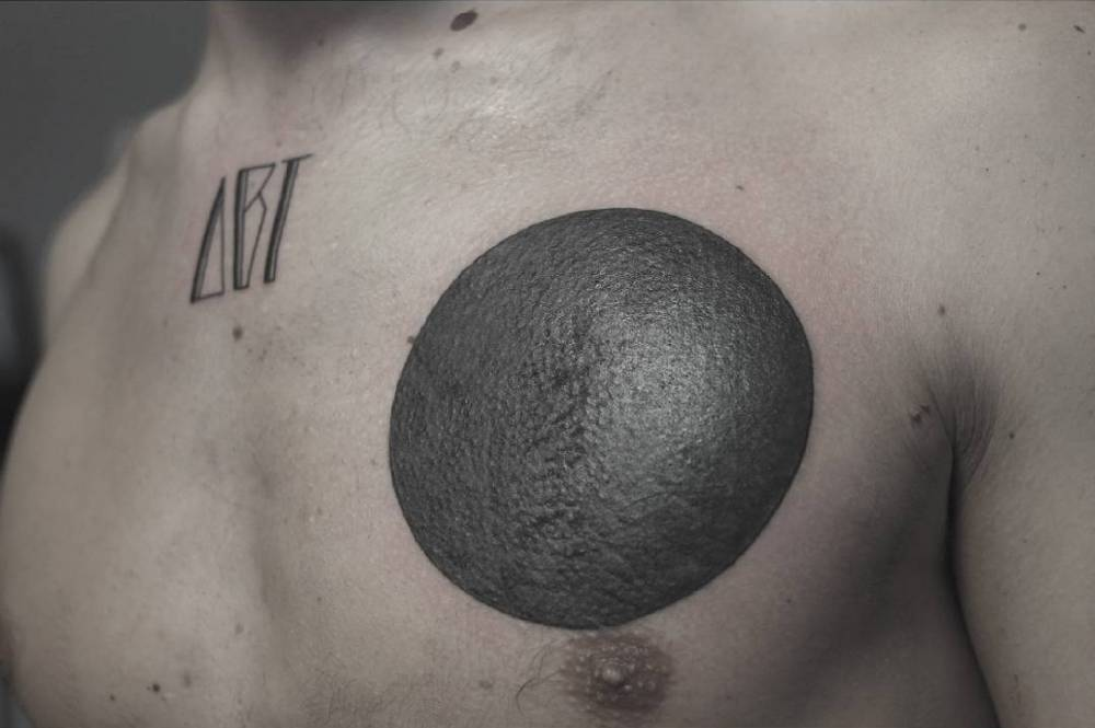 Blackwork Circle Tattoo On The Left Side Of The Chest