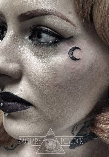 Small moon tattoo next to the left eye for Small eye tattoo