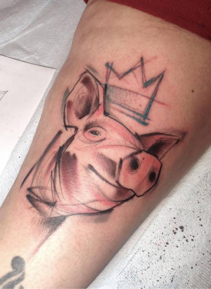 Sketch work style king pig tattoo on the left thigh.