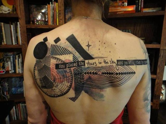 "Graphic upper back tattoo that includes the phrase ""You placed the stars in the sky and you know them by name."""