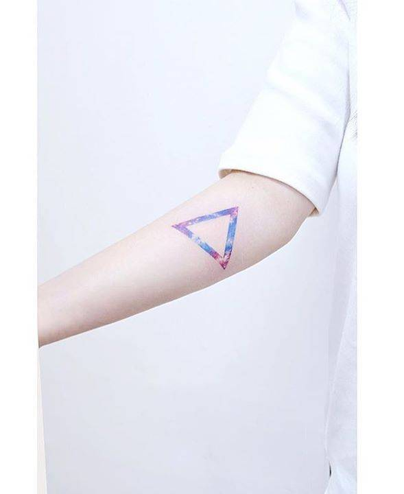 Galactic triangle tattoo on the right inner forearm.
