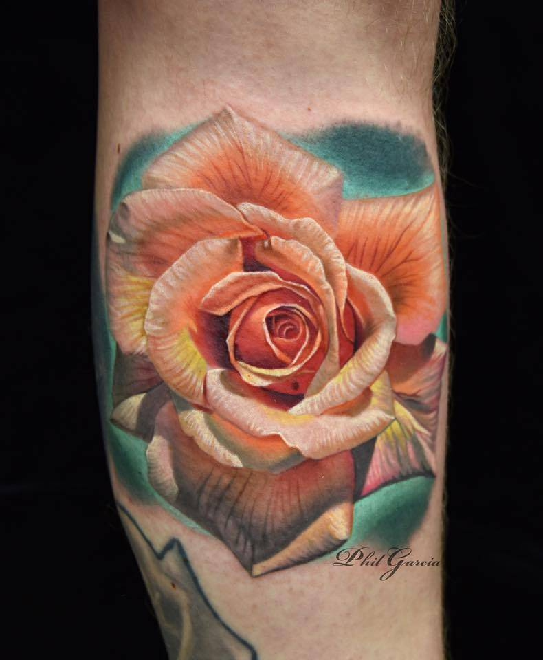 Realistic orange rose tattoo on the left lower leg.