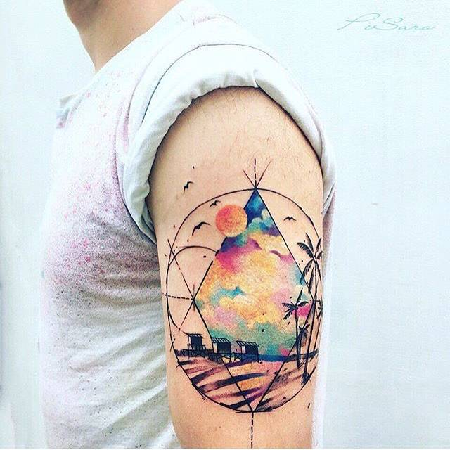 beach landscape tattoo on the left upper arm