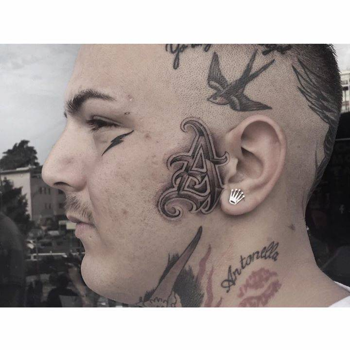 Side Of Face Tattoos: Single Needle Lettering On The Left Side Of The Face