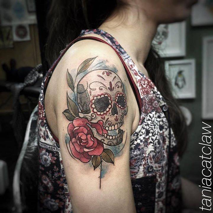 Sketch work style sugar skull on the right shoulder.