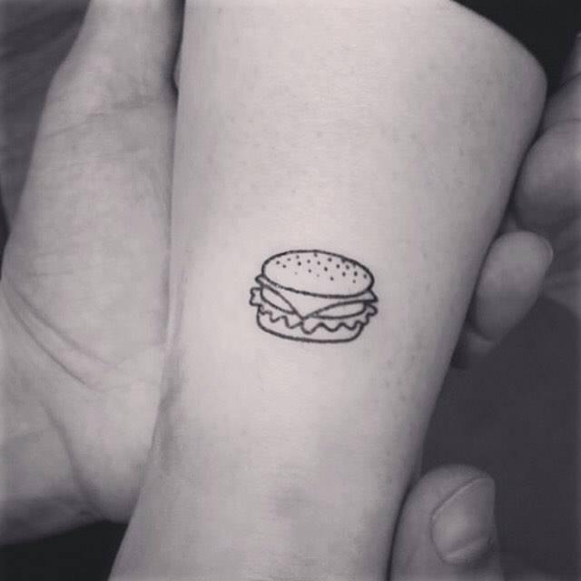 Hamburger tattoo on the Achilles heel.