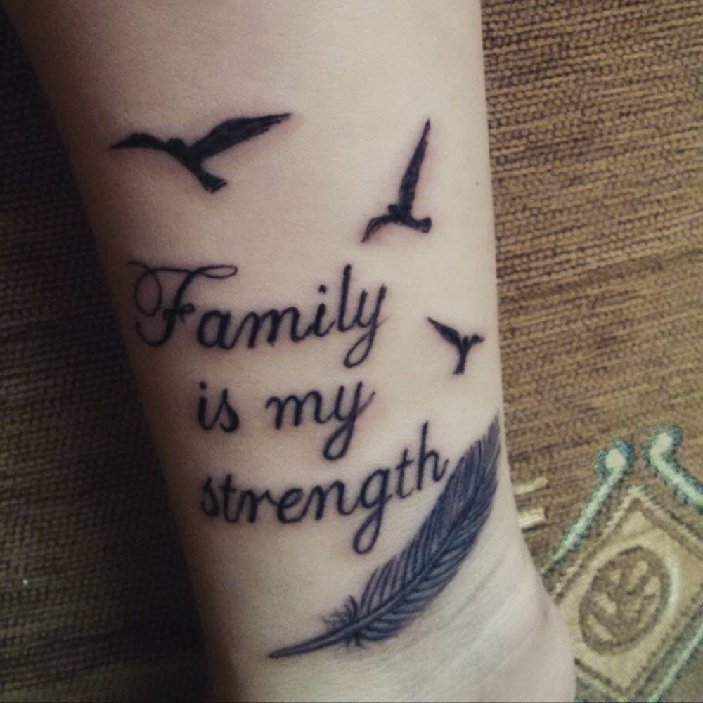 "Forearm Tattoo Saying ""Family Is My Strength"" Together"
