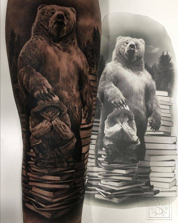 Black and grey bear tattoo on the right inner forearm.