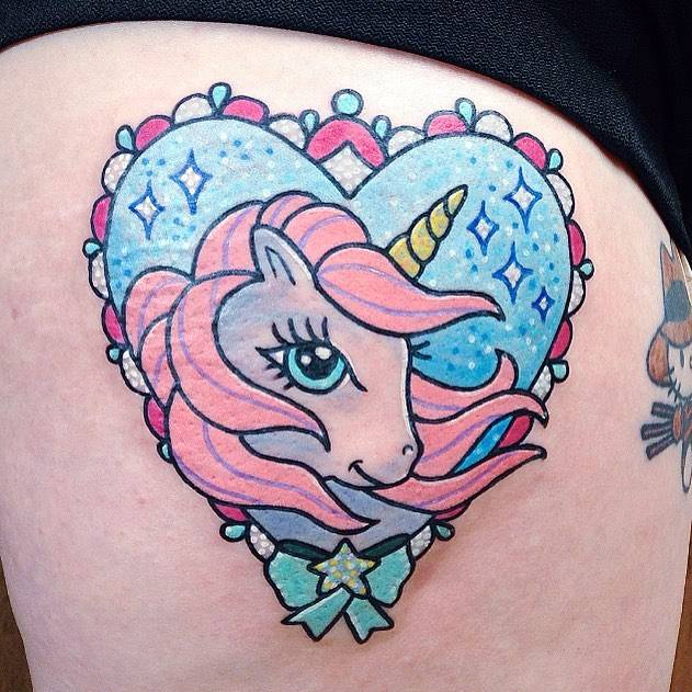 Small kawaii style unicorn tattoo on the right thigh.