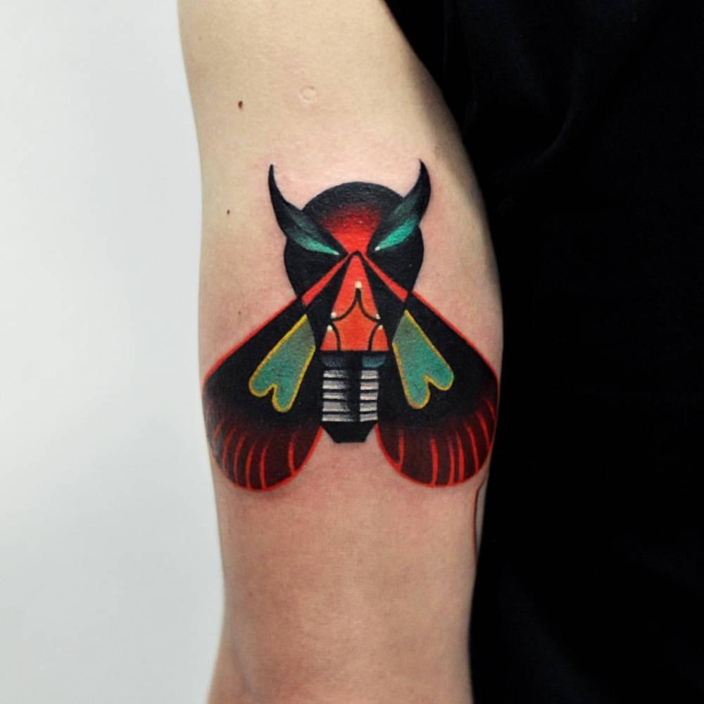 Surrealist moth bulb tattoo done at Kult Tattoo Fest.