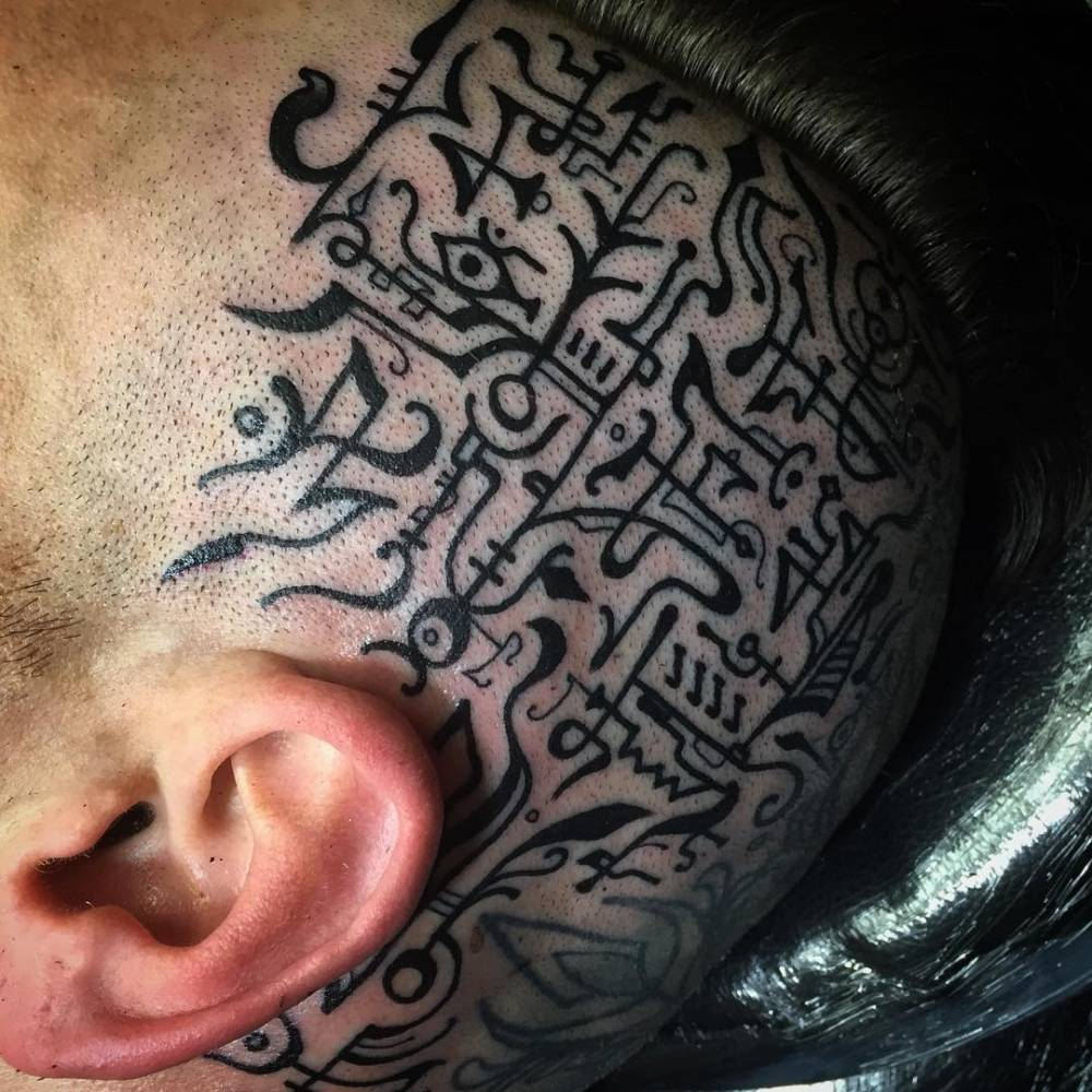 Beautiful sigil tattoos on the left side of the head.