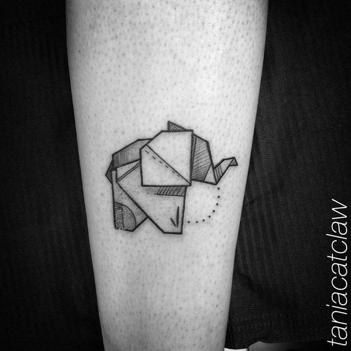 Origami elephan tattoo on the leg.