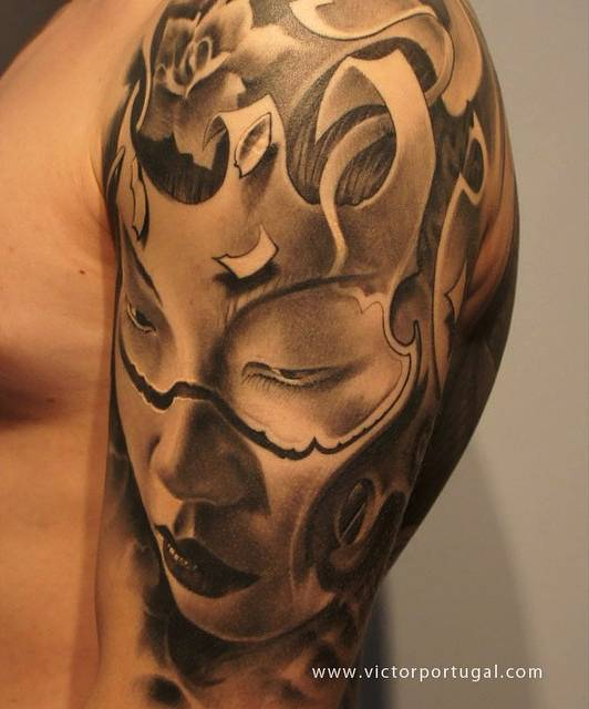 Black and grey geisha tattoo on the left upper arm and shoulder.