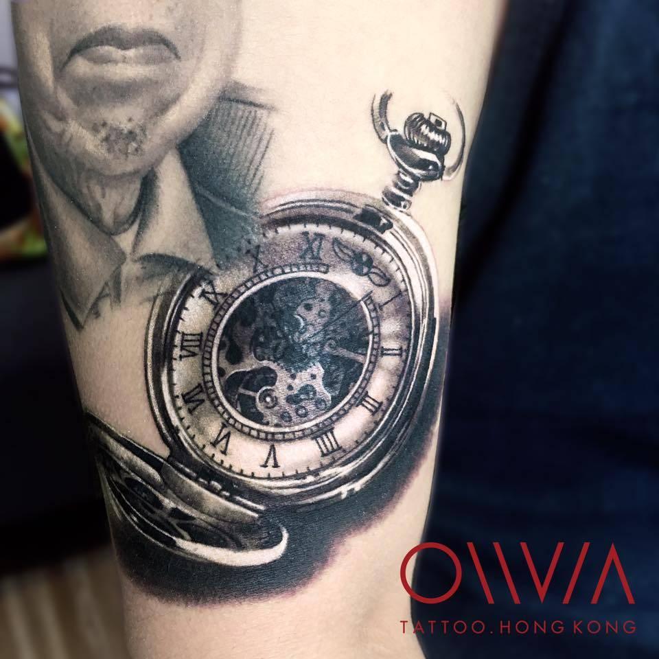 Black and grey pocket watch tattoo.