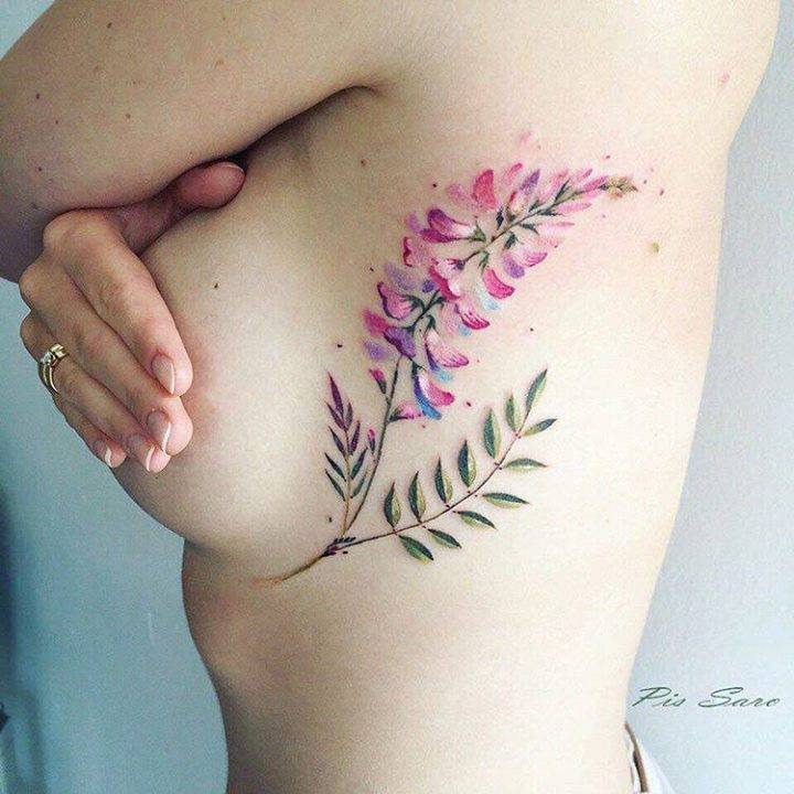 Pink flower tattoo on the left side ribcage mightylinksfo
