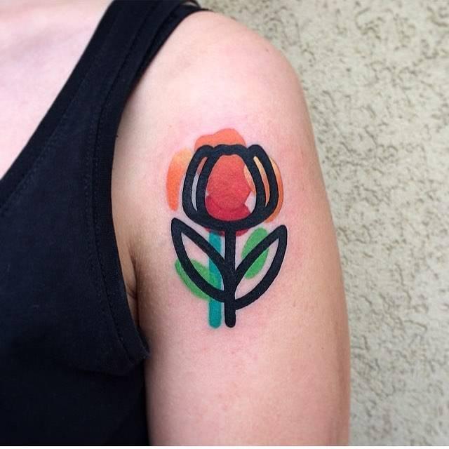Destructured orange tulip tattoo on the left shoulder.