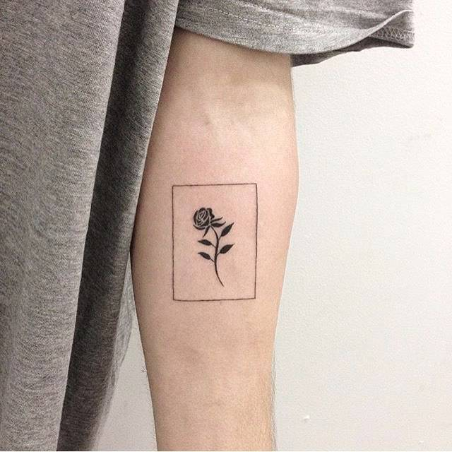 rose tattoo on the inner forearm.