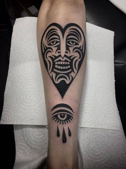 Heart face and eye tattoo on pewdiepie 39 s forearm for Sang bleu tattoo