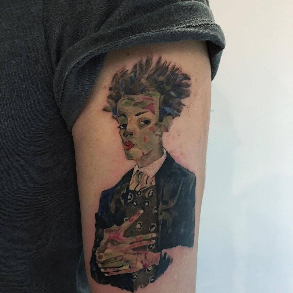 "Egon Schiele's ""Self-Portrait with Peacock Waistcoat, Standing"" inspired tattoo on the left upper arm."