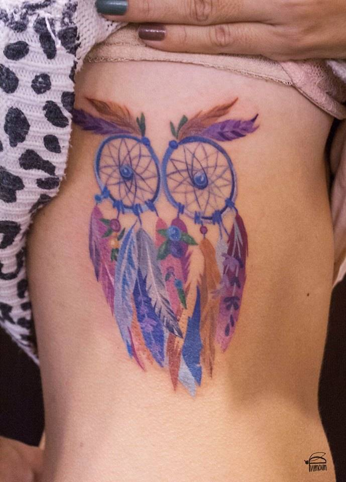 Watercolor dreamcatcher-owl tattoo on the right side.
