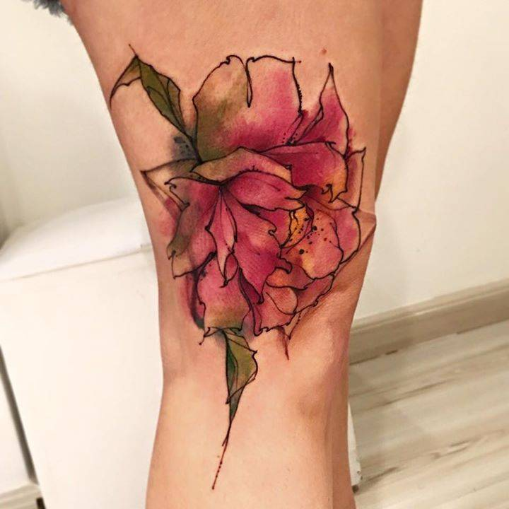Sketch work peony tattoo on the right thigh.