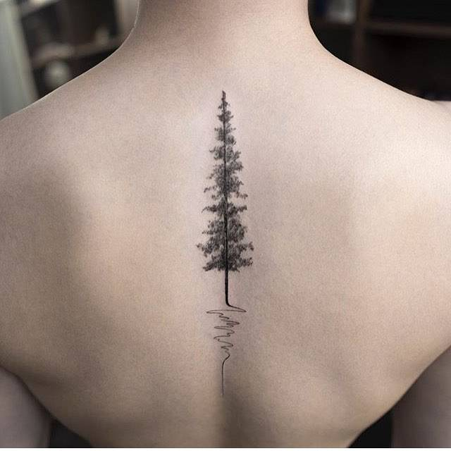 tree tattoo on the upper back.