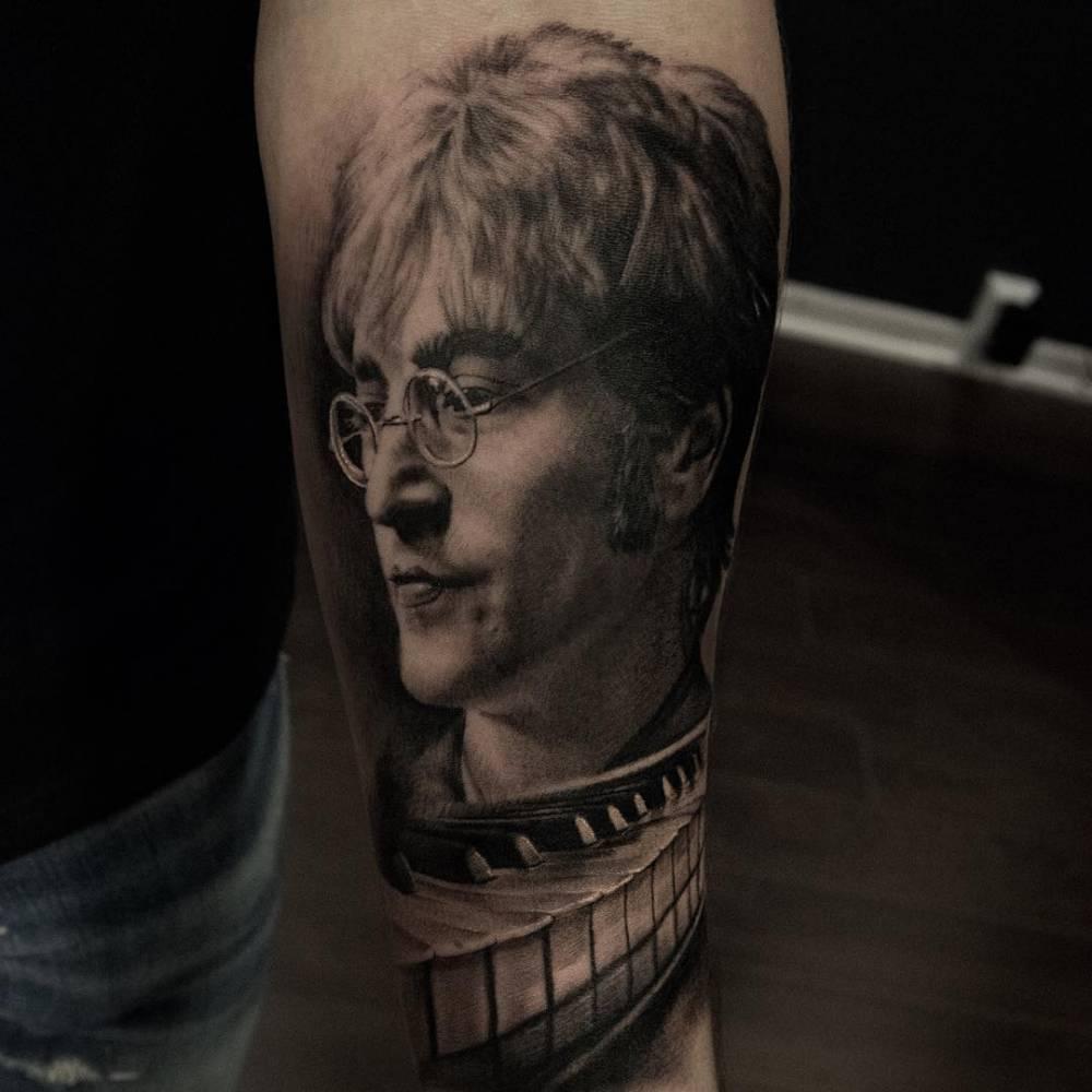 Black And Grey Style John Lennon Tattoo On The Left