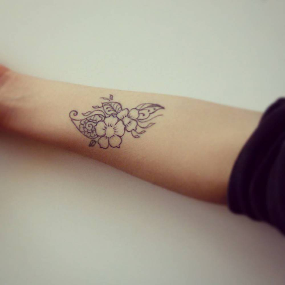 Forearm Tattoo Of A Bunch Of Flowers On Elisa