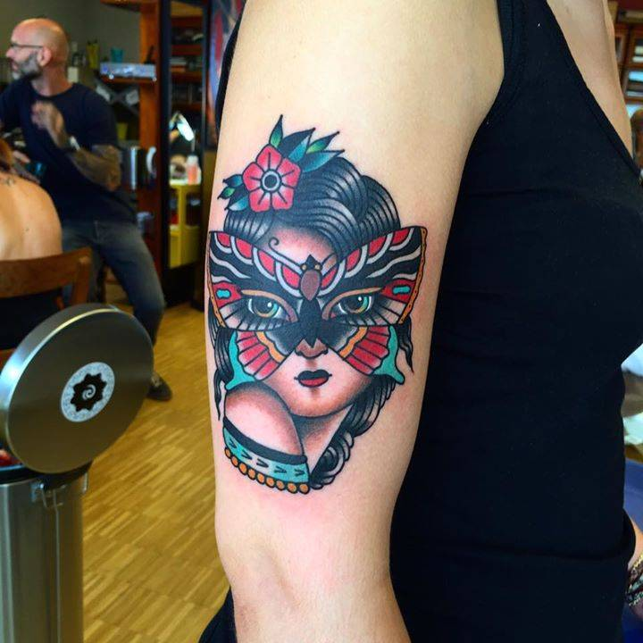 Traditional Style Woman With Butterfly Mask Tattoo On