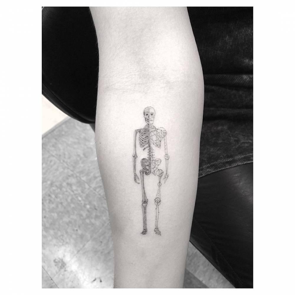 2ca600c3f Fine line skeleton tattoo on the right inner forearm.