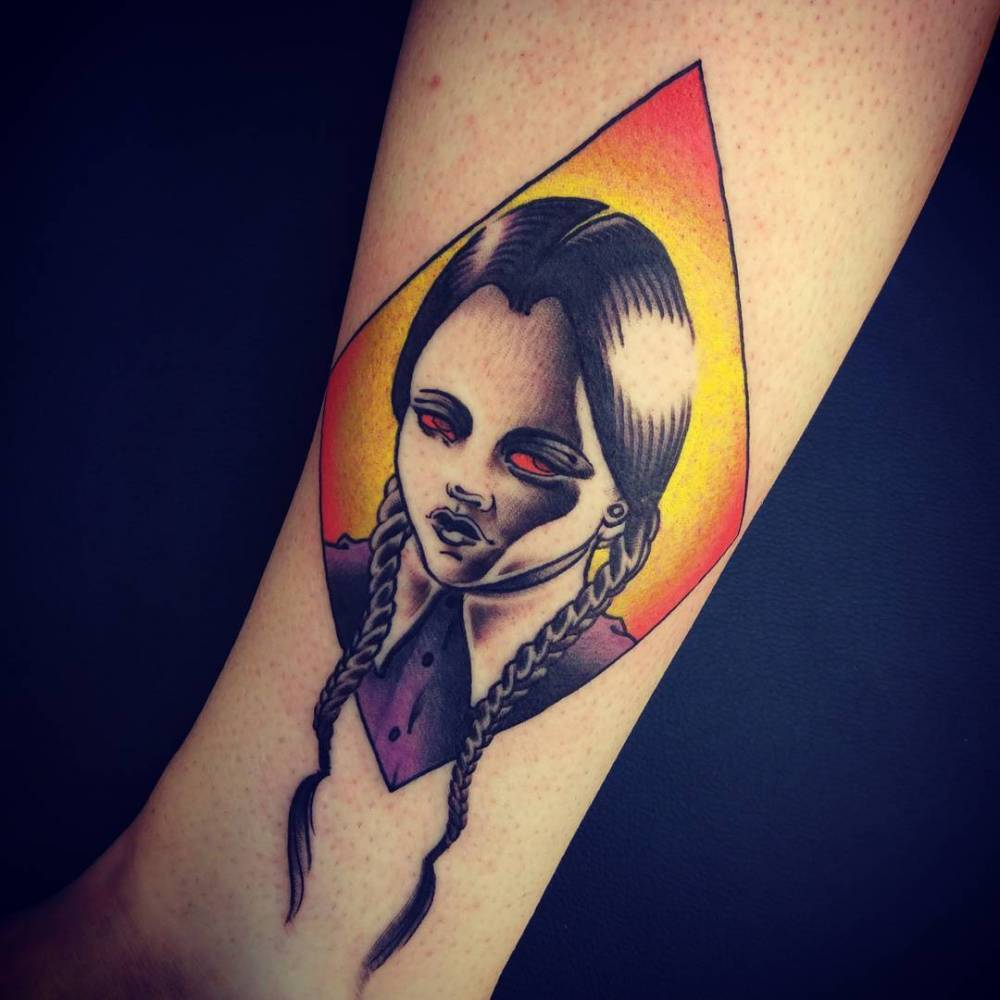Wednesday Addams portrait tattoo on the leg.